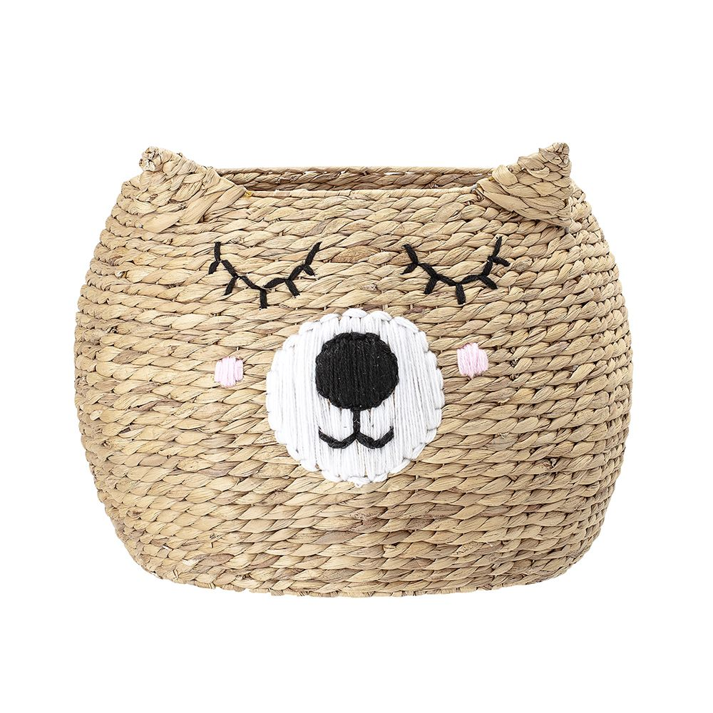 a sleeping bear-shaped basket