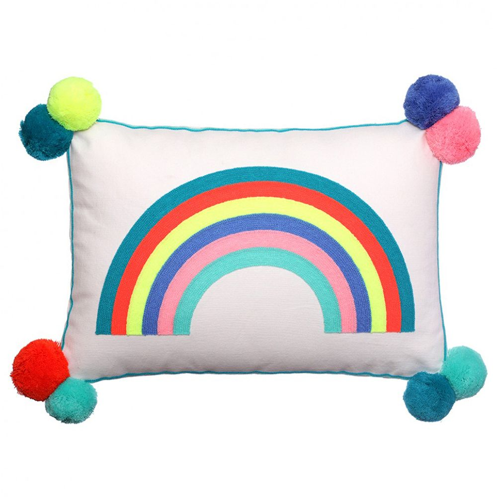a square rainbow cushion with pompoms