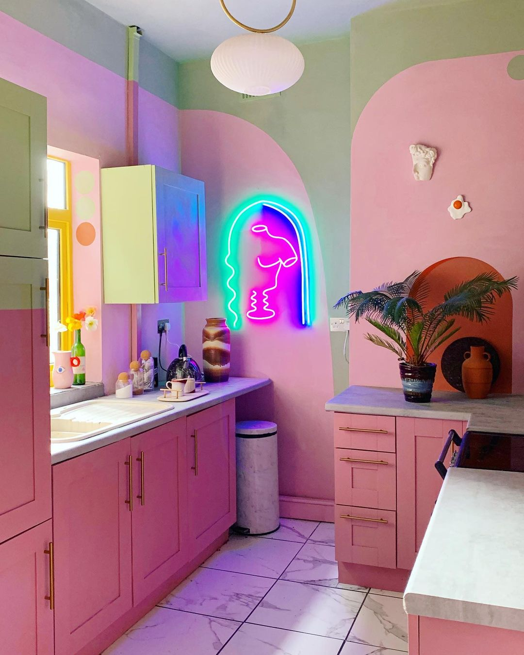 beautiful pink and green kitchen