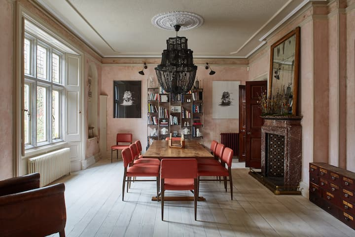 a luxuriousdining room on a Victorian estate
