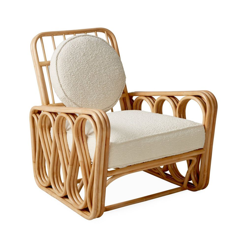 luxurious rattan and boucle armchair