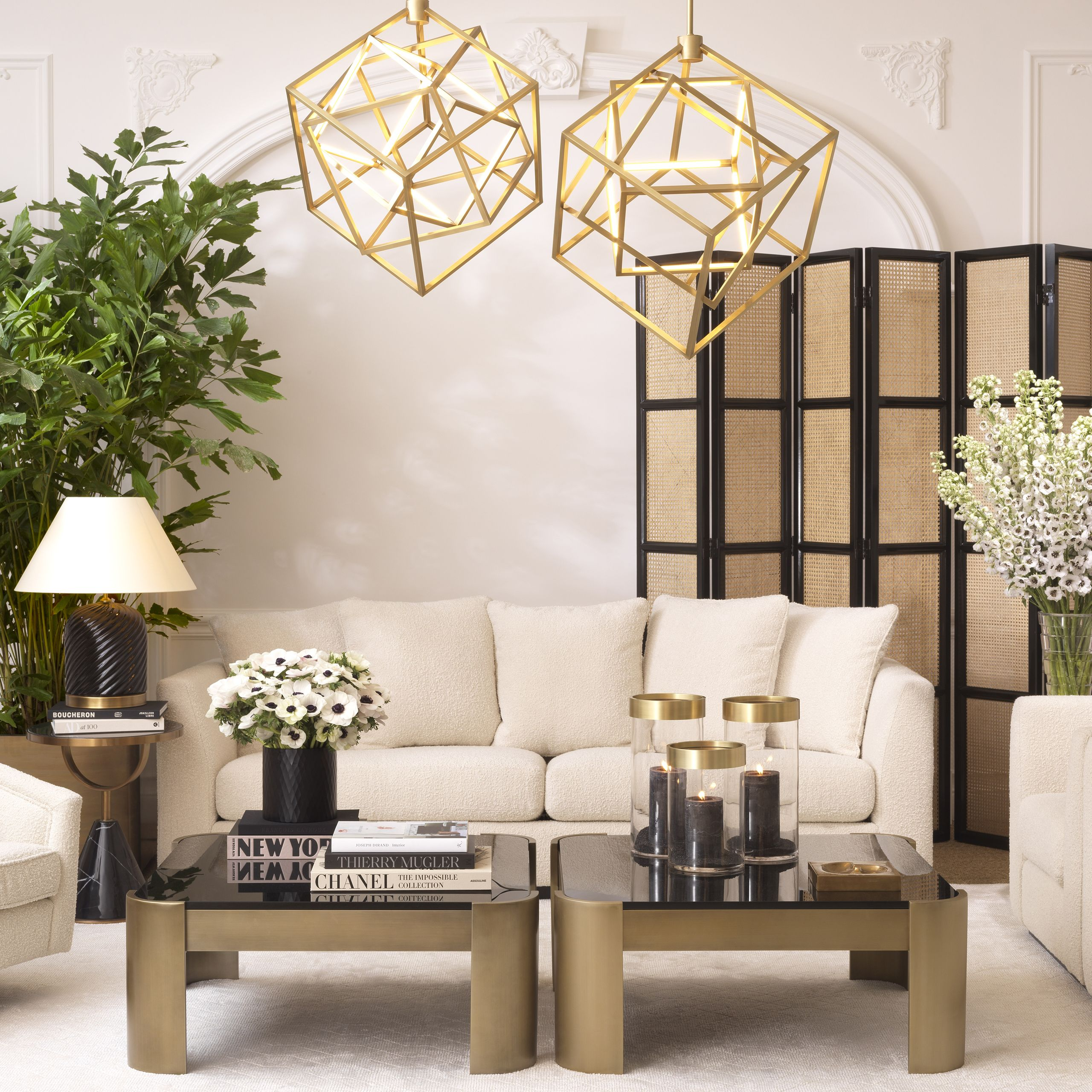 a fabulous living room with brass, rattan and boucle furniture