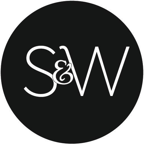 Stylish curved brass framed mirror