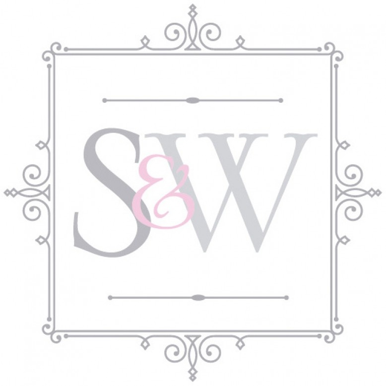 Glossy white console table with brass finished legs